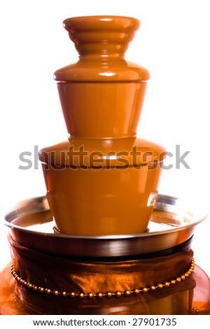 Chocolate  fountain on white background - stock photo