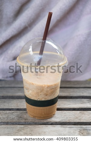 Chocolate Frappe on wood table - stock photo