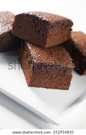 Chocolate fudge brownies with milk in a high key light - stock photo