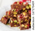 Chocolate Fudge with Glace Cherries, Pistachios and Coconut, square - stock photo