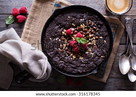 Chocolate giant skillet cookie with walnuts and milk chocolate chips - stock photo