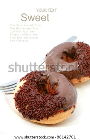 chocolate glazed doughnut with sprinkles isolated on white background
