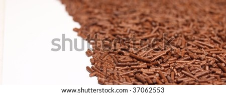 Chocolate granules background, low depth of focus - stock photo