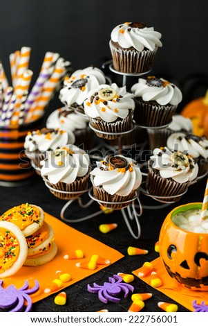 Chocolate Halloween cupcakes with white buttercreme icing and chocolate shavings on top. - stock photo