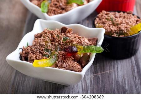 Chocolate Halloween dessert  with gummy worms, selective focus - stock photo