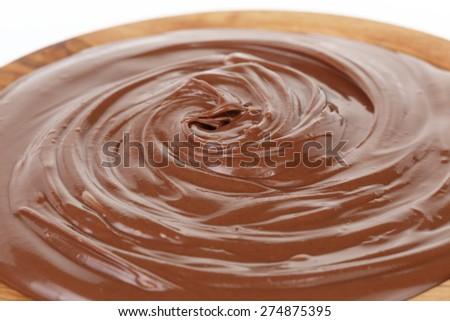 chocolate hazelnut cream in wood bowl - stock photo