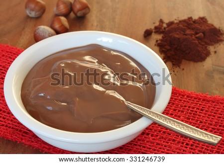 chocolate hazelnut pudding with ingredients around - christmas dessert - stock photo