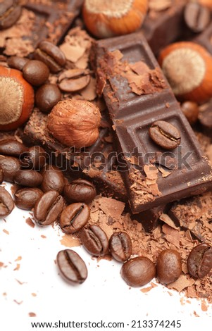 Chocolate, hazelnuts and coffee beans. - stock photo