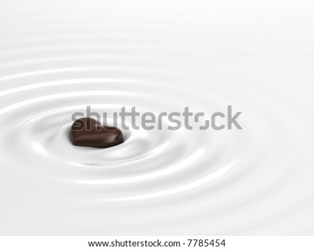 Chocolate heart in milk - stock photo