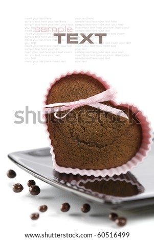 chocolate heart shape muffin in pink silicone mold (with easy removable sample text) - stock photo