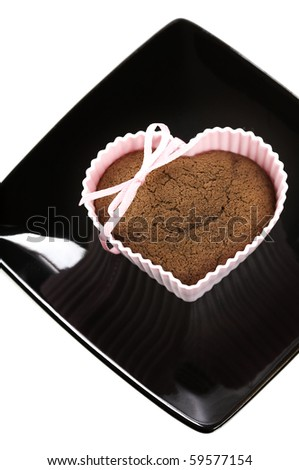 chocolate heart shape muffin in red silicone mold - stock photo