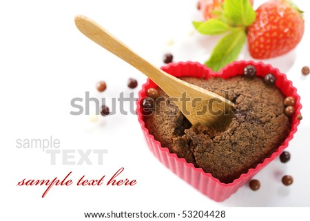 chocolate heart shape muffin in red silicone mold, fresh strawberry  and mint (with sample text) - stock photo
