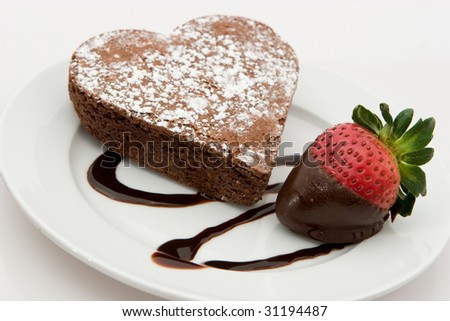 Chocolate Heart Shaped Brownie With Strawberry - stock photo