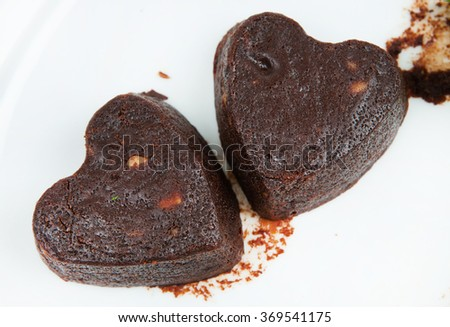 Chocolate hearts cakes with ice in a plate. Valentine chocolate dessert. Cookies in the Shape of Heart at Valentine Day.romantic food. - stock photo