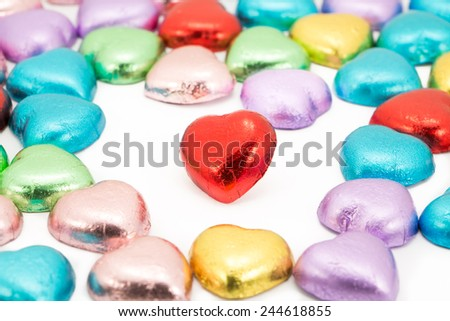 chocolate hearts candies on white - stock photo