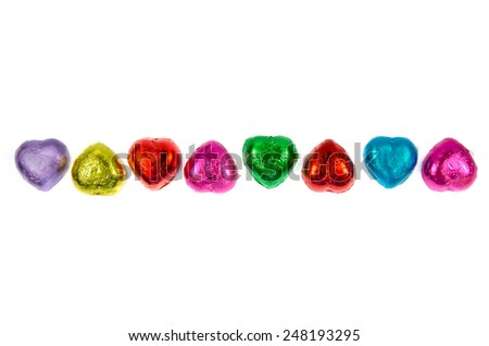chocolate hearts candies on white background - stock photo