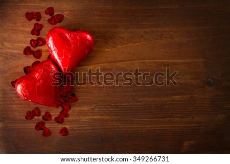 Chocolate hearts on wooden board, Valentines Day background, selective focus