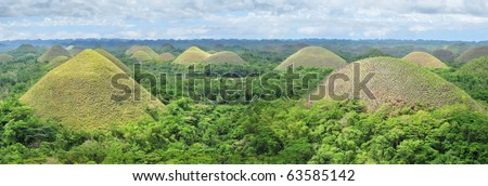 Chocolate Hills in Bohol, Philippines are earth mounds scattered all over the town of Carmen. - stock photo