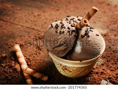 Chocolate ice cream on wooden background - stock photo