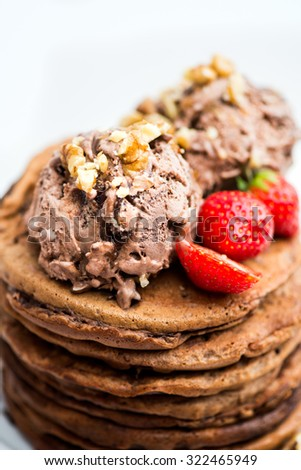 Chocolate Ice Cream Scoop with Chocolate Pieces on the Stack of Pancakes, selective focus, shallow DOF, macro shot - stock photo