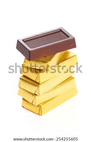 Chocolate in gold wrappers isolated on white background - stock photo