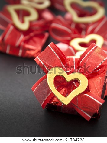 Chocolate in red foil - stock photo