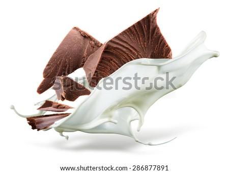 Chocolate is falling into milk. Splash isolated on white background - stock photo
