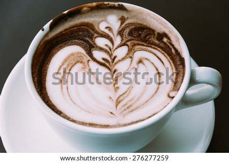 chocolate latte - soft focus with vintage film filter - stock photo