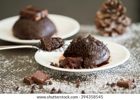 Chocolate Lava Cake  with nuts and white sugar.