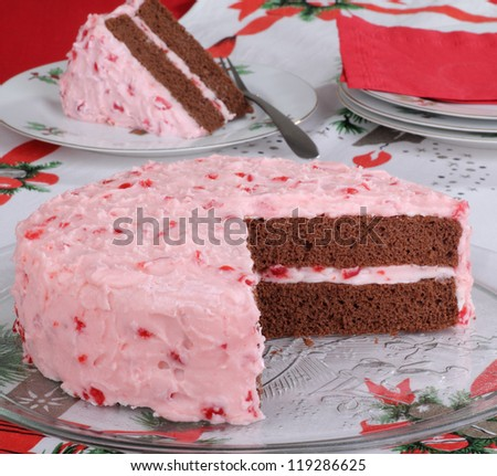 Chocolate layer cake with cherry icing on a Christmas platter - stock photo