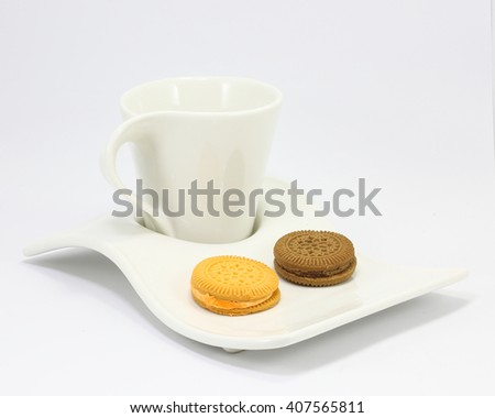 Chocolate Lemon orange cream sandwich biscuit cookie cup and saucer on white background  - stock photo