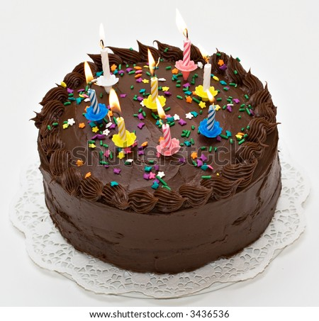 Chocolate-lover's birthday cake with lit candles. - stock photo