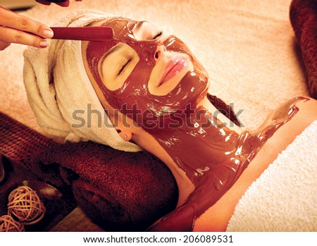 Chocolate Luxury Spa. Facial Mask. Spa therapy for young woman with cosmetic mask at beauty salon. Wellness. Chocolate Mask Facial Spa. Chocolate Treatments. Beauty Spa Salon  - stock photo