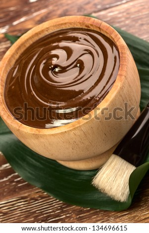 chocolate mask in a bowl - stock photo