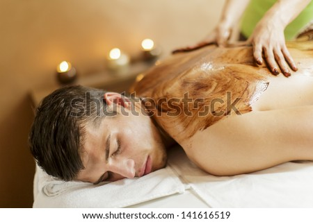 Chocolate massage - stock photo