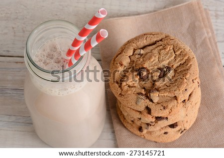 Chocolate Milk and Cookies shot from a high angle. Horizontal format on a wood kitchen table. After school treat. - stock photo