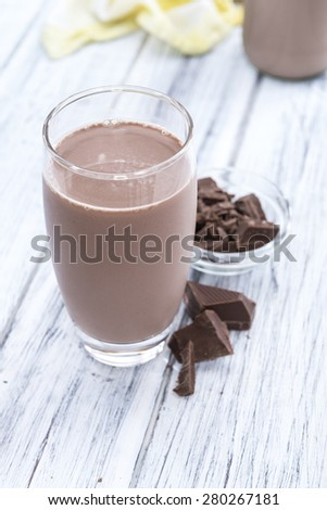 Chocolate Milk (close-up shot on bright wooden background) - stock photo