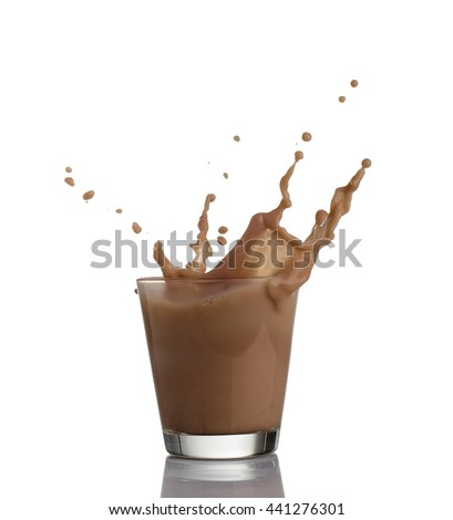 chocolate milk or protein milkshake flowing into a glass, making  big splash, isolated on white background - stock photo