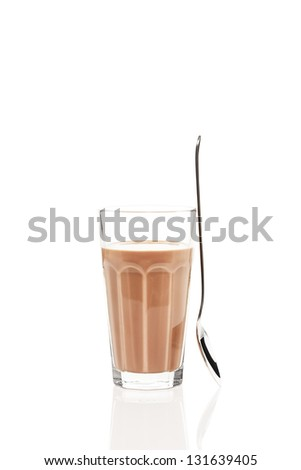 chocolate milk with a standing spoon on white background - stock photo