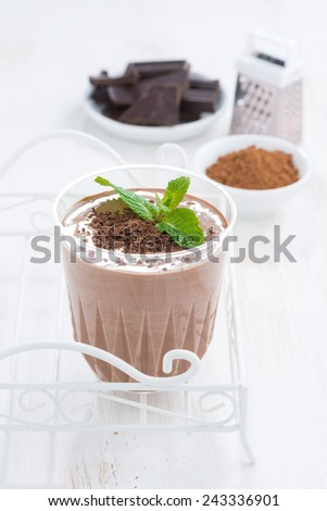 chocolate milkshake and ingredients, vertical - stock photo