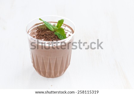 chocolate milkshake in a glass on white wooden table, horizontal - stock photo