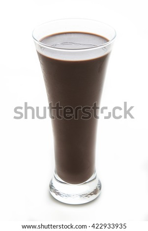 Chocolate milkshake in a slim glass against a white background - stock photo