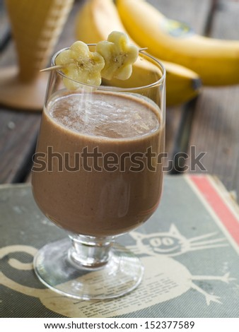 Chocolate milkshake with banana, selective focus - stock photo