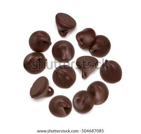 Chocolate morsels spread on white background from top