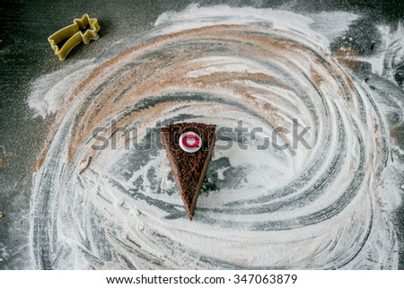Chocolate mousse cake with like and comment button on a dusted table with sugar powder and cocoa (christmas style) - stock photo