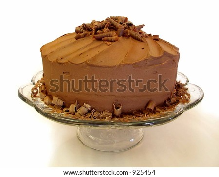 chocolate mousse cake with spiral chocolate shavings on top viewed from side - stock photo