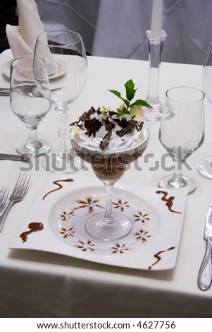 Chocolate mousse on dinner table - stock photo