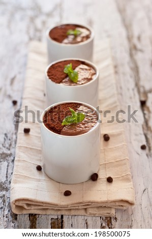 chocolate mousse servings with fresh mint leaves - stock photo