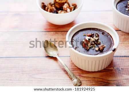 chocolate mousse with walnut pieces, food closeup - stock photo