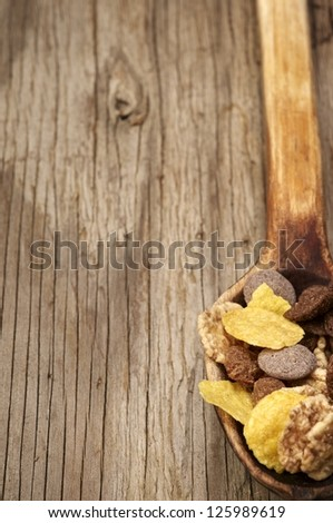 Chocolate muesli in wooden spoon - stock photo